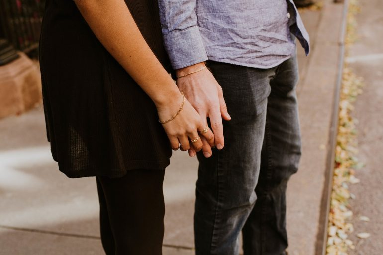 couple holding hands after saving their marriage