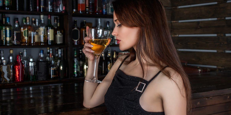 woman at a bar playing hard to get