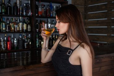 woman at a bar playing hard to get