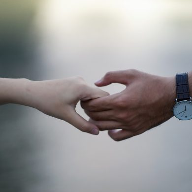 a man and a woman's hands slowly separating because the woman doesn't know how to keep a man in her life