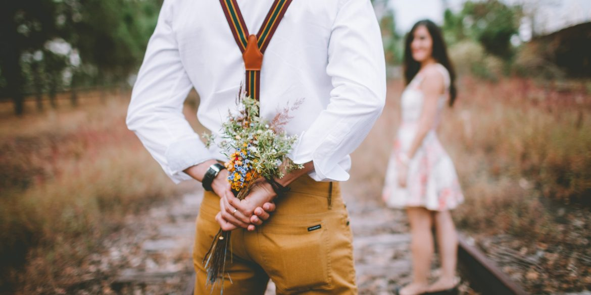 man giving his ex flowers because he wants to get back with her