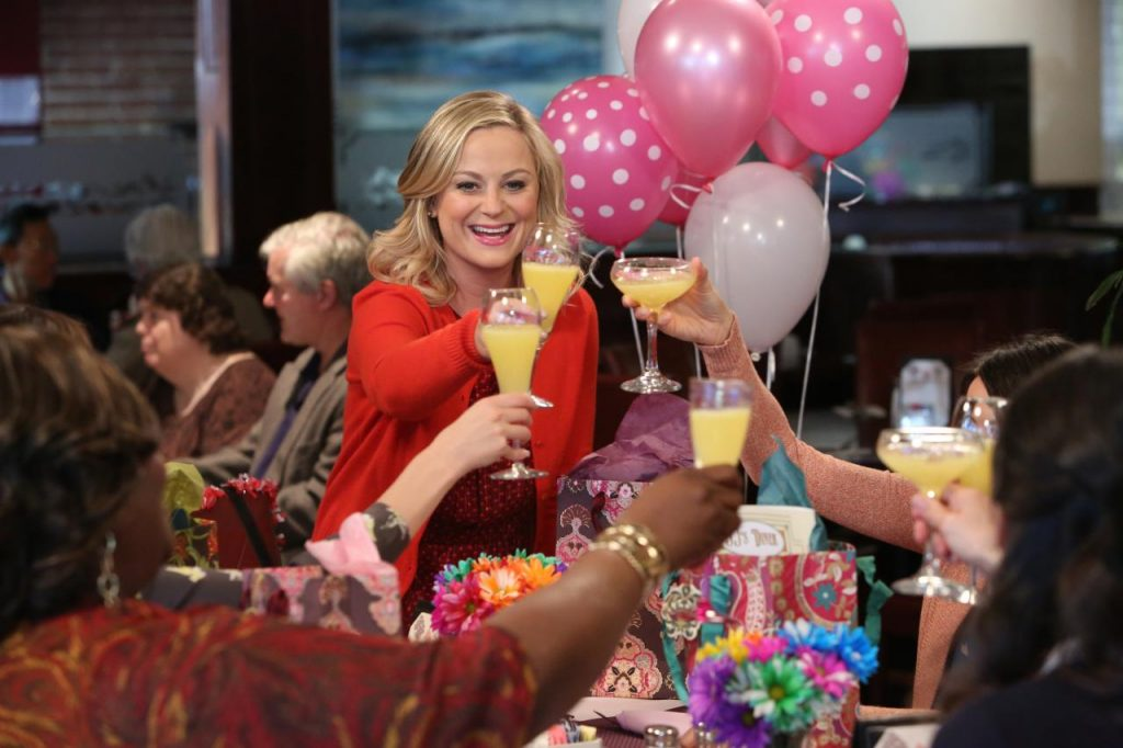 amy poehler from parks and recreation celebrating galentine's day with her girlfriends