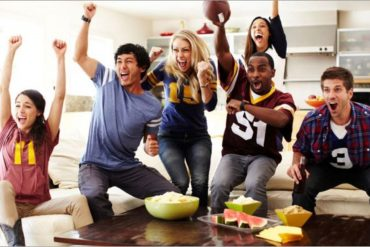 friends enjoying themselves at a super bowl party