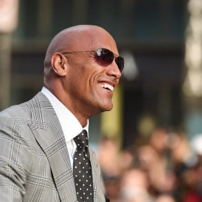 the rock dwayne johnson rocking a bald head and looking powerful
