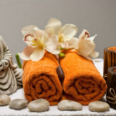 buddha statue and towels and candles for self care routine