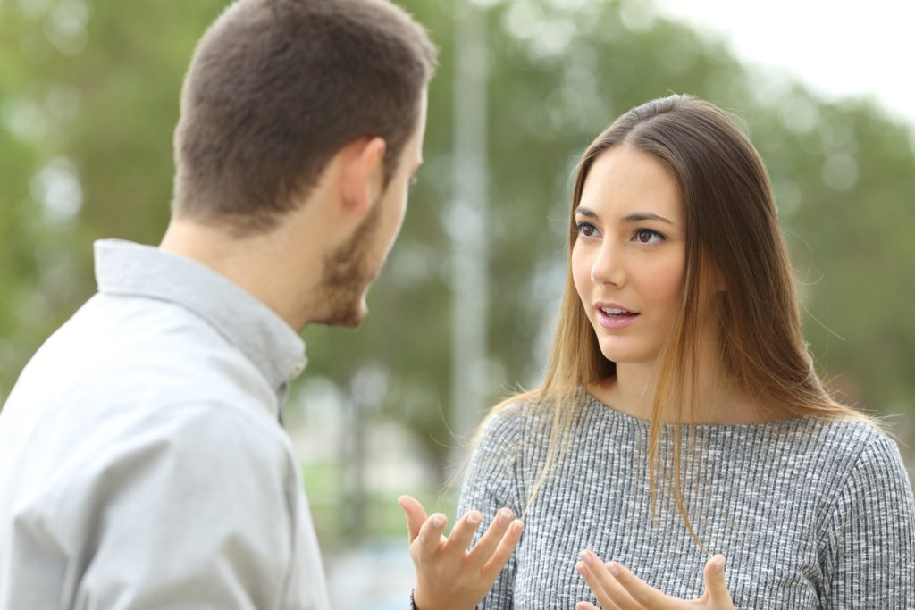 a woman letting a guy know she's not interested in him