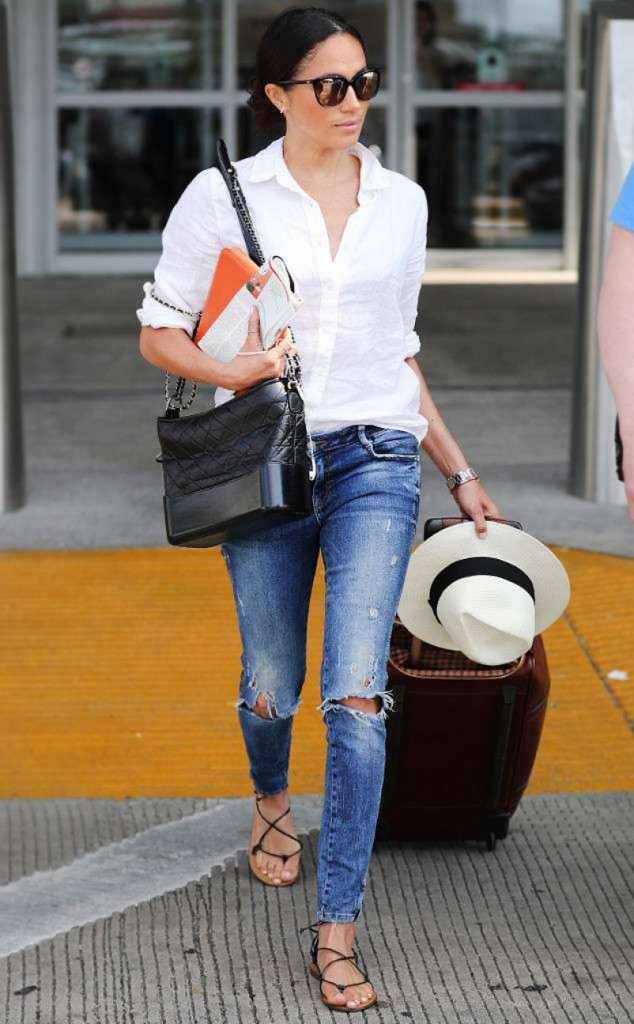 meghan markle in her signature fedora and style