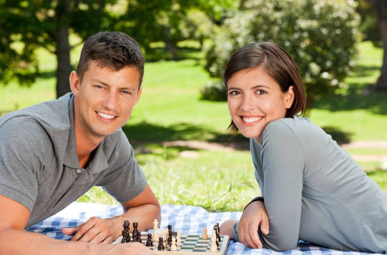 couple playing chess and bonding together